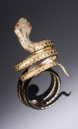 Kraftig slangering af 18 kt. Guld med brillanter og rubiner