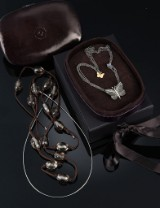 Ole Lynggaard. 'Katrine' butterfly clasp, 18 kt. oxidized red gold with diamonds, three necklaces (4)