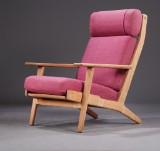 Hans J. Wegner. High-backed easy chairs, Getama, model 290A, oak/wool