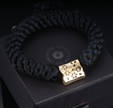 Ole Lynggaard. Lace lock in 18 kt. glossy red gold with diamonds, plus silk armband (2)