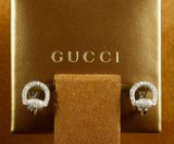 Gucci. Horse-bit earrings, 18 kt. gold with diamonds