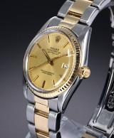 Rolex 'Datejust'. Vintage herreur i 18 kt. guld og stål med champagnefarvet skive, ca. 1979