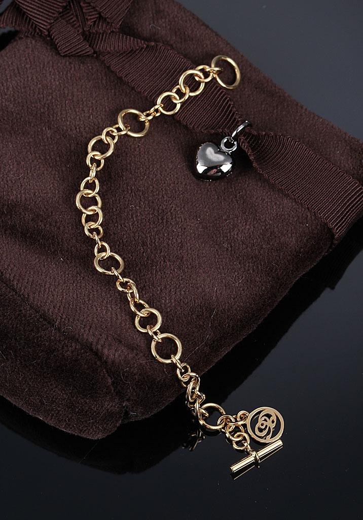 Ole Lynggaard. My Little World armlænke i 18 kt. guld - Ole Lynggaard. My Little World armlænke i 18 kt. guld. L. 14 cm, vægt 7,1 g. Art.nr. C2012-405. Medfølges af Ole Lynggaard velourpose. Vejl. udsalgspris 13.600,-