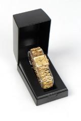 Omega De Ville. Dameur af 18 kt guld.