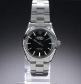 Rolex 'Air-King Precision'. Herreur i stål med sort skive, ca. 1980
