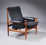 Finn Juhl. Bwana lænestol med stel af teak, betrukket med sort læder