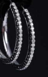 Hartmann's. Diamond hoop earrings, 18 kt. black rhodium-plated white gold, total approx. 3.87 ct. (2)