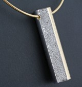 Necklace with integral diamond pendant