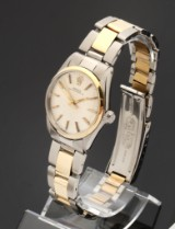 Rolex Oyster Perpetual. Vintage mid-size watch, 18 kt. gold and steel, c. 1968