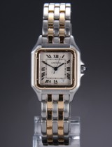 Cartier 'Panthere'. Mid-size watch, 18 kt. gold and steel, with date, c. 1990