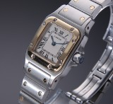 Cartier 'Santos Lady'. Ladies watch, 18 kt. gold and steel with pale dial, 2000s