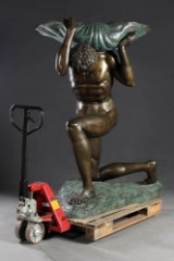 Triton with shell. Bronze sculpture, brown and green patina