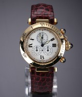 Cartier 'Pasha Chronograph'. Large ladies' watch in 18 kt. gold with original strap and clasp, 1990s