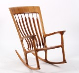 Morten Stenbæk. 'Low Rocker', unique rocking chair in red elm and walnut
