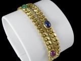 Armbånd af 18kt. guld med safir, rubin og smaragd