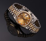 Rolex 'Tridor'. Ladies watch, tri-coloured 18 kt. gold with diamond dial, c. 1984