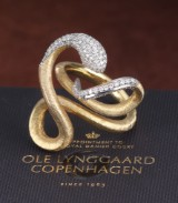 Ole Lynggaard. 'Snake' diamond ring in 18 kt. gold and white gold