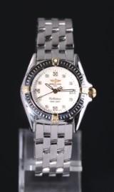 Breitling Callistino damearmbåndsur. Stål, 18 karat guld og diamanter