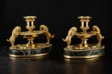 A pair of gilt bronze and marble French candlesticks, 19th-century, Empire style (2)