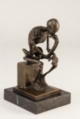 Skelet i bronze.