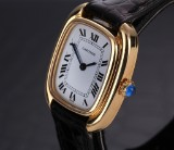 Cartier 'Tonneau'. Ladies watch, 18 kt. gold with original strap and clasp