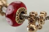 Pandora bracelet with 28 14 kt. gold charms