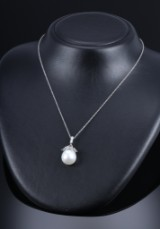 South Sea cultured pearl and diamond pendant, 14 kt. white gold,  Pearl dimensions: approx. 15.33 x 16.42 mm