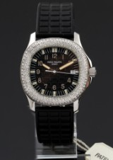 Patek Philippe 'Aquanaut'. Mid-size steel watch with date and diamond bezel