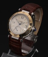 Cartier 'Pasha'. Unisex, 18 kt. gold and steel with power reserve