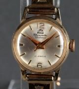 Utilitas Chronometer. Dameur af 14 kt guld