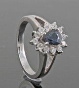 Diamond ring in 18kt with sapphire approx. 0.39ct