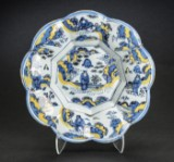 A large Baroque undulating dish, blue and yellow faience, c. 1700