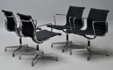 Charles Eames. A set of four armchairs, model EA-108, black hopsack (4).