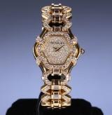 Treasury Swiss. Dameur i 18 kt. guld med diamanter, 2000'erne