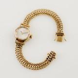 Tissot damarmbandsur med armband i 18 k guld