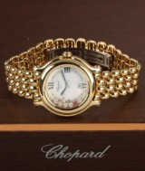 Chopard 'Happy Diamonds'. Mid-size watch, 18 kt. gold with diamonds and rubies