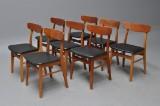Farstrup møbler; Otte stole i teak og bøg med sort skai (8)