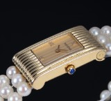 Boucheron 'Reflet'. Ladies watch, 18 kt. gold with diamond dial and pearl bracelet, 1990s