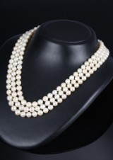 A three-strand vintage necklace with saltwater cultured pearls and diamond clasp, total approx. 1.75 ct