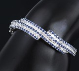 Diamond and sapphire bracelet, 18 kt. white gold, dimond total approx. 3.40 ct. Internal Ø approx. 14 cm.