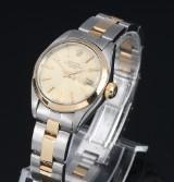 Rolex 'Date'. Dameur i 18 kt. guld og stål med champagnefarvet skive, ca. 1980
