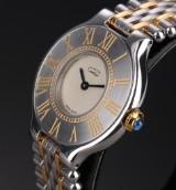 Cartier 'Must de Cartier 21'. Ladies watch, 18 kt. gold and steel with sapphire, 1990s