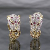 Pair of 'Panther' ear studs in gold with rubies and diamonds, approx. 1.00 ct. (2)