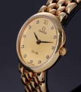 Omega. 'De Ville', ladies watch in 18 kt. gold with diamond-studded dial