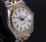 Rolex Datejust. Mid-size ladies watch, 18 kt. gold and steel with white dial, c. 1987