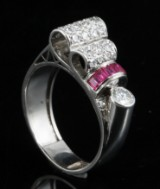 Ring in 18k set with diamonds and rubies approx. 0.59 & 0.24ct