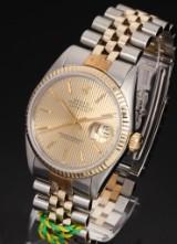 Rolex Datejust. Men's watch, 18 kt. gold and steel, 1982