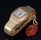 Cartier 'Santos Galbee Moonphase'. Men's watch, 18 kt. gold with date and phases of the moon