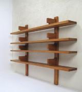 A shelving system / wall shelf, 1970s/1980s, of solid elm wood, by Deutsche Werkstätten