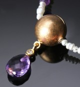Ole Lynggaard. Globe clasp with key system, 18 kt. satin-finish gold, key pendant and three necklaces (5)